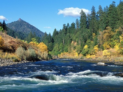 tall peaks and lush vegetation grace the rogue river of southern oregon